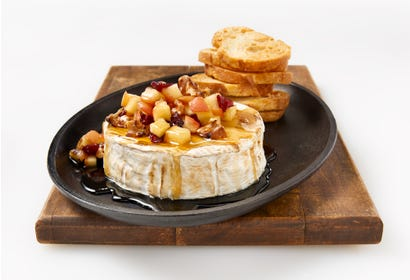 Brie with maple syrup, apples and walnuts Image