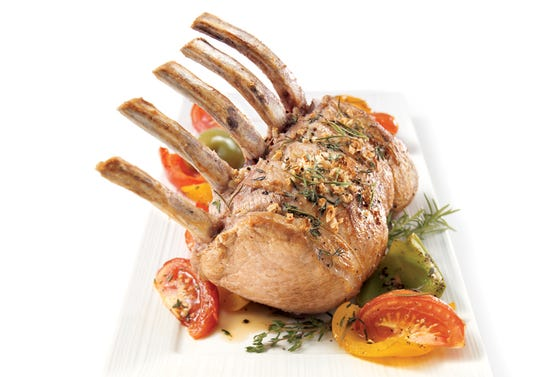 Rack of pork with tomatoes, bell peppers and herbs