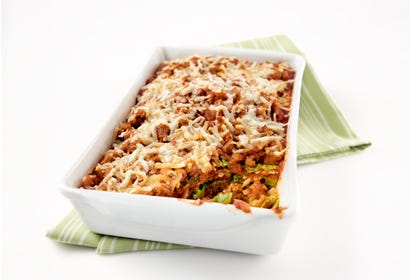 Casserole of cabbage layered with Italian sausage and Parmesan Image
