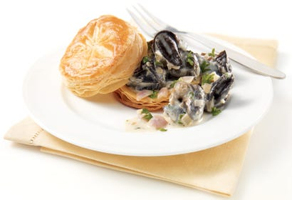 Escargot and goat cheese puff pastries Image
