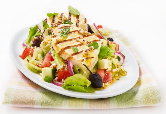 Grilled halloumi cheese on mixed salad