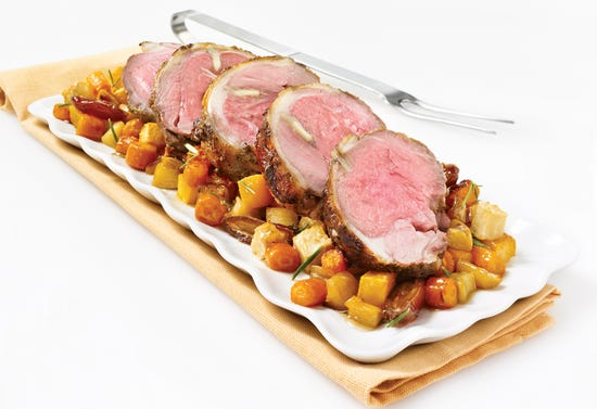 Roast leg of lamb with honey and root vegetables