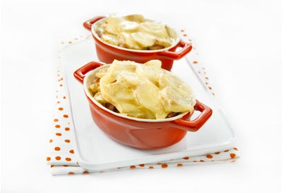 Mini casseroles of potatoes with bacon and Migneron Image