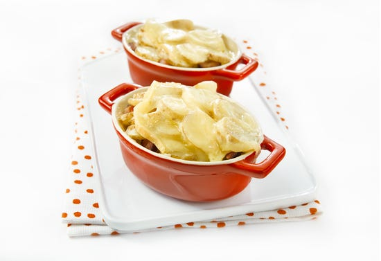 Mini casseroles of potatoes with bacon and Migneron