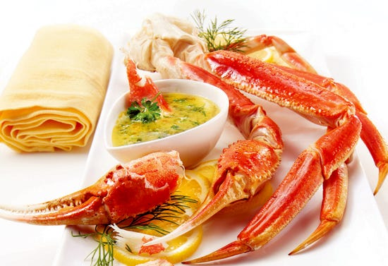Crab legs and butter with herbs