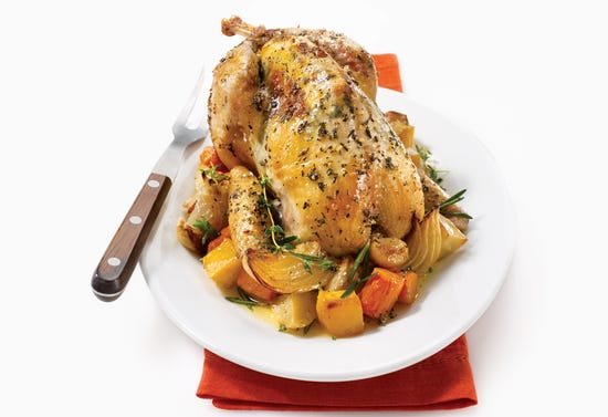 Roasted guinea fowl with herbs and root vegetables
