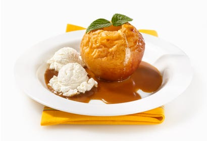 Baked apples with vanilla ice cream and cider coulis Image