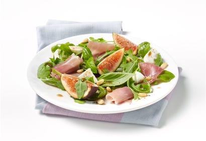 Fresh fig, mozzarella, prosciutto and basil salad Image
