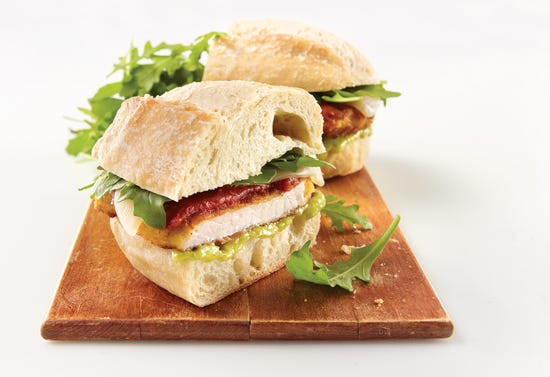 Italian sandwiches with pork, mozzarella, aragula and marinara sauce