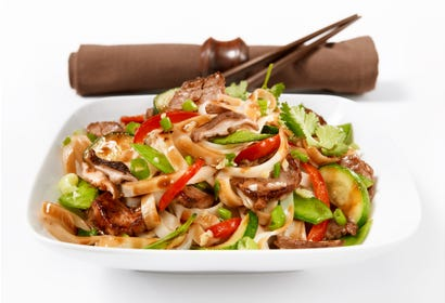 Asian noodles sauté with pork and vegetables Image