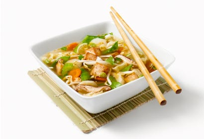Asian soup with vegetables and tofu Image