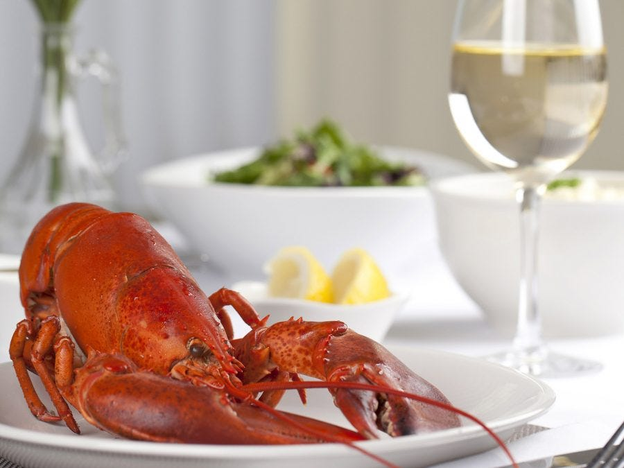 a lobster and a glass of wine