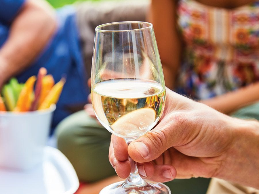 Glass of wine on summer picnic